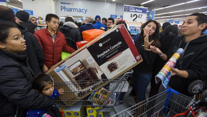Bargain hunters crowd a Walmart to take advantage of their so-called 'Black Friday' sales on Thanksgiving Day 2014 in Fairfax, Virginia.