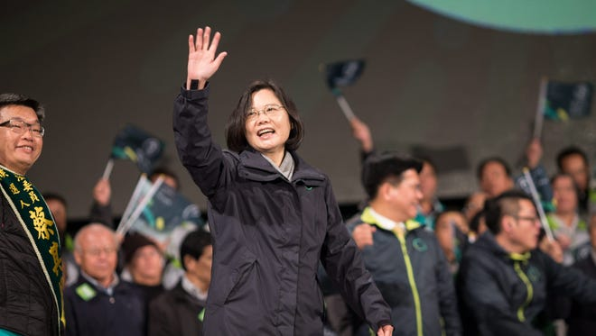 The chairwoman of the pro-independence Democratic Progressive Party (DPP) and presidential candidate Tsai Ing-wen waves to supporters during a campaign rally in Taichung, Taiwan.