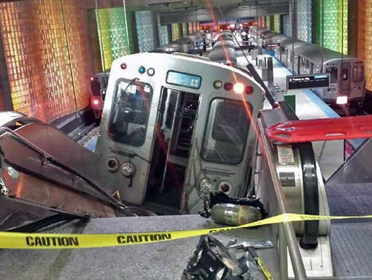 A Chicago Transit Authority train car rests on an escalator at the O'Hare International Airport station after it derailed on March 24. Thirty-two people were injured after an eight-car commuter train plowed across a platform and scaled an escalator at one of the nation's busiest airports.