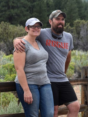 Ultra runner Chet Fairbank stands next to his wife, Micheline, at the Ophir Creek Trail at Davis Creek Park on Monday.