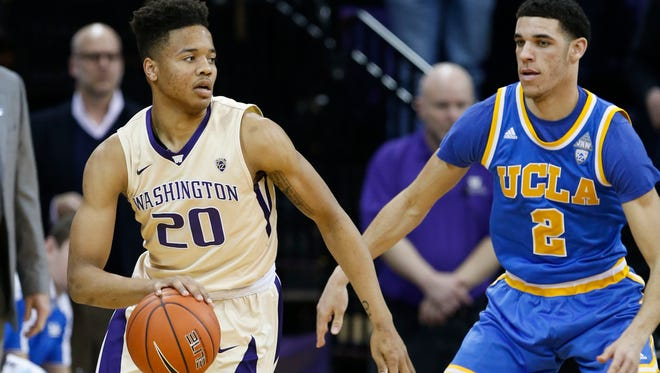 Washington Huskies guard Markelle Fultz (20) dribbles against UCLA Bruins guard Lonzo Ball (2) during the first half at Alaska Airlines Arena at Hec Edmundson Pavilion.