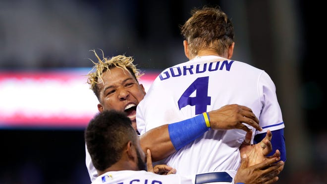 Salvador Perez, left, celebrates with Alex Gordon and Jorge Bonifacio after Gordon's sacrifice fly in the 9th inning gave the Royals a 4-3 win over the Tigers at Kauffman Stadium on July 19, 2017.