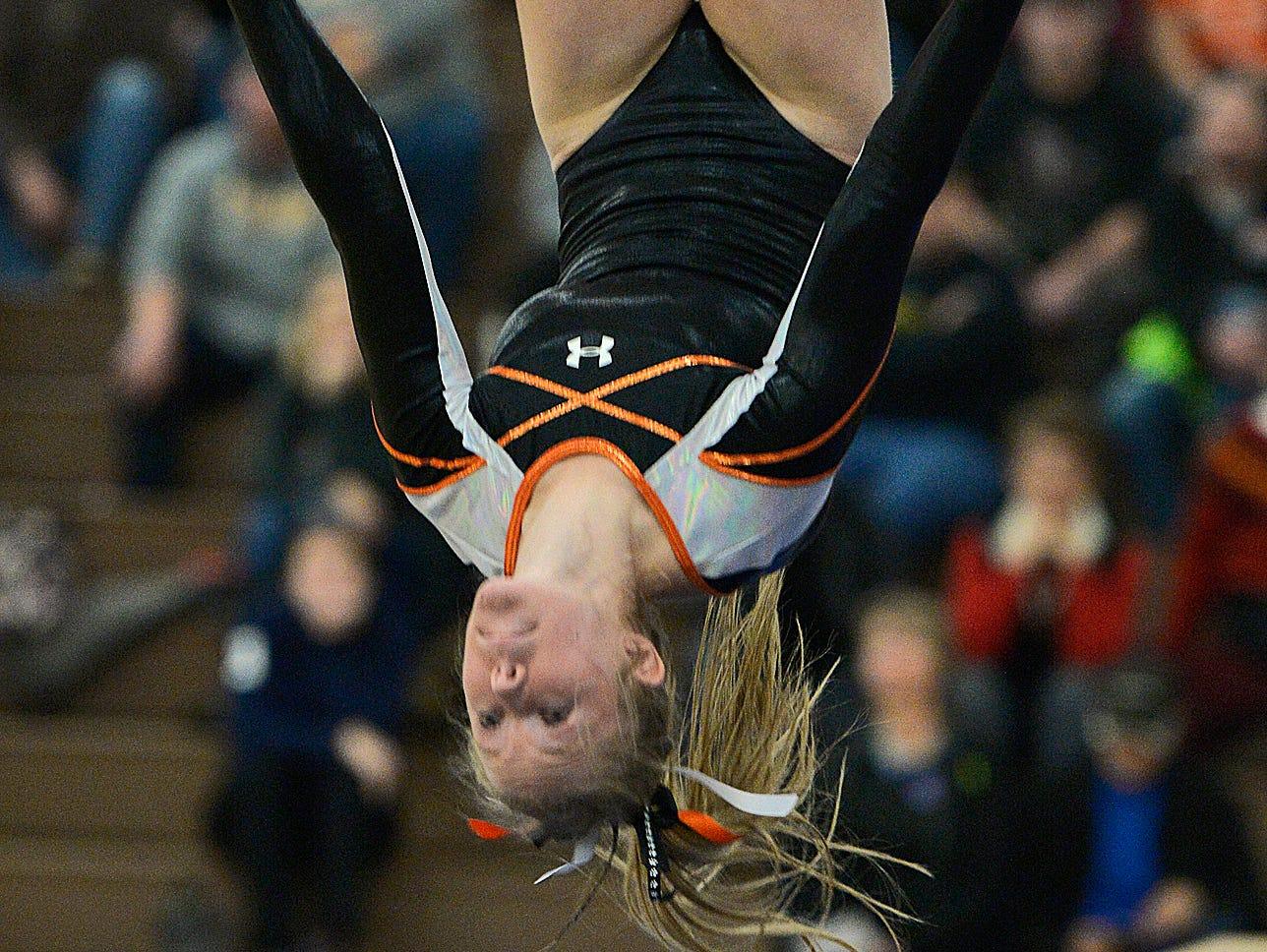 St. Cloud Tech senior gymnast Kalley Thompson dismounts after her balance beam routine Saturday, Dec. 5 during the St. Cloud Apollo Gymnastics Invite.