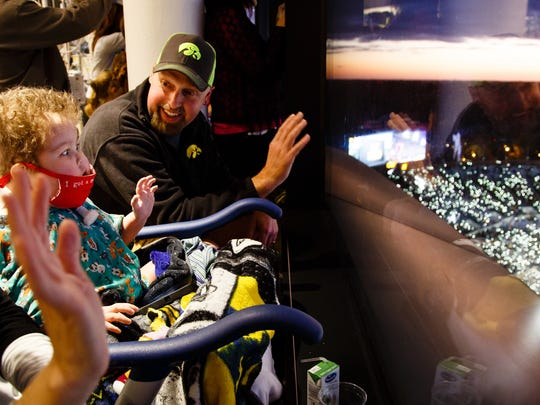 """I don't think you understand it until you see it through your kids eyes,"" said Chris Kohn of the fans at Kinnick Stadium waving to the children, including his son Will, in the UI Stead Family Children's Hospital after the first quarter of their game against Minnesota on Saturday, Oct. 28, 2017, in Iowa City."