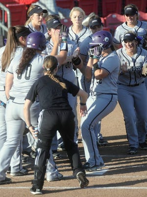 Joey D. Richards/Reporter-News Abilene Christian players welcome Miranda Herron at home plate after Herron hit a solo home run in the third inning. Herron's blast gave the Wildcats a 2-0 lead, and they held on beat Texas Tech 3-1 in the nonconference game Wednesday in Lubbock.