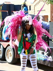 Patrick Johnston/Times Record News A costumed dancer participates in the parade during the Midwestern State University Caribbean Students Organization's annual Caribfest Saturday afternoon on the MSU campus. The three-day festival wrapped up Saturday with the parade, an authentic Caribbean meal and a Glow Fete.