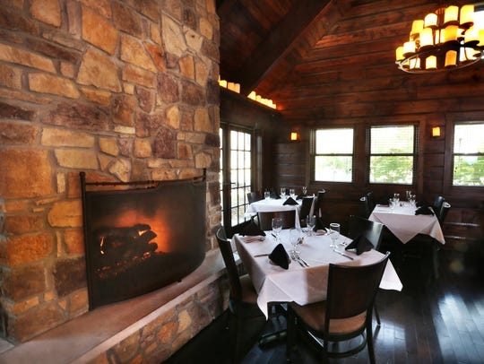 A gas fireplace cozies up the dining room of Meridian
