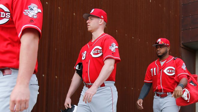 From left: Cincinnati Reds starting pitcher Anthony DeSclafani (28) walks out of the clubhouse to take the field during Cincinnati Reds spring training, Friday, Feb. 17, 2017, at the Cincinnati Reds player development complex in Goodyear, Arizona.