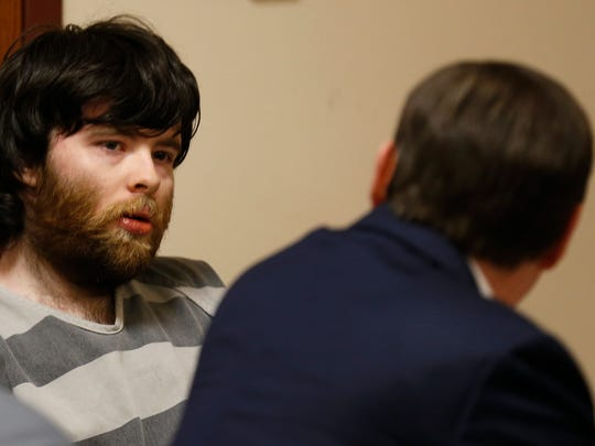 Nicholas Godejohn talks to his attorney in a News-Leader file photo.
