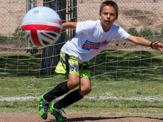 Elias Flanery, 10, attempts to stop the ball during