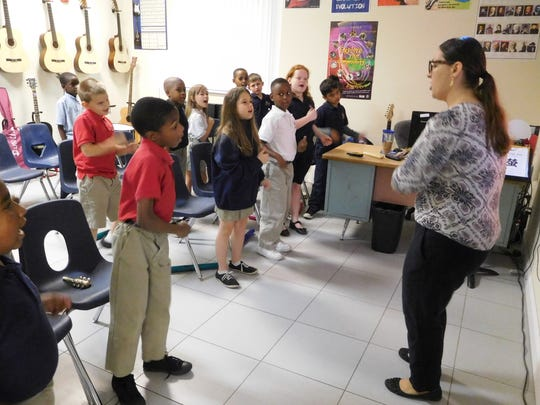 Melissa Carlson's music students sing together.