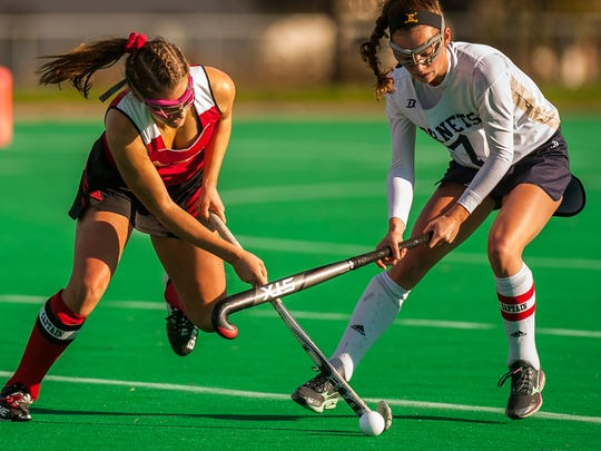 Lydia Maitland gets a stick on the ball during a high school field hockey semifinal game in the fall.
