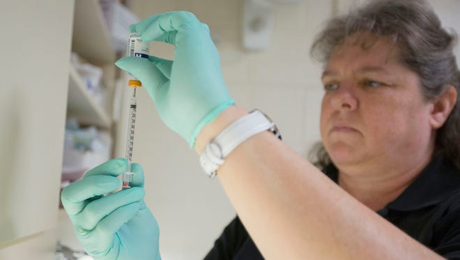 Nurse Cindy Gage prepares an insulin injection for an inmate on Thursday, March 2, 2017, at the Marion County Jail clinic in Salem.