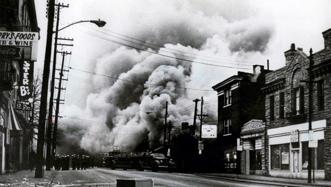 Thick smoke billows from businesses at the corner of Reading Road and Rockdale Avenue in Avondale in April 1968. This Enquirer file photo was taken from the corner of Reading and Prospect Place, looking north on Reading. The current site of the Urban League of Greater Southwestern Ohio office is on the immediate right.