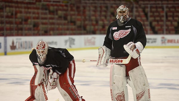 Wings goalies Jimmy Howard and Petr Mrazek hit the ice during practice Wednesday.