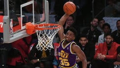 Utah Jazz guard Donovan Mitchell (45) dunks over children