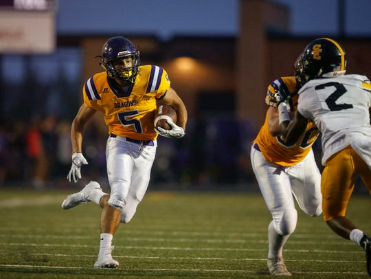Johnston junior receiver Anthony Coleman runs the ball