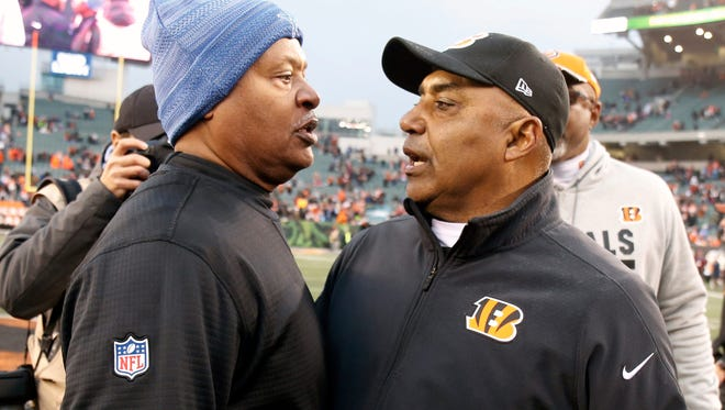Lions coach Jim Caldwell, left, meets with Bengals coach Marvin Lewis after the Lions' 26-17 loss on Sunday, Dec. 24, 2017, in Cincinnati.