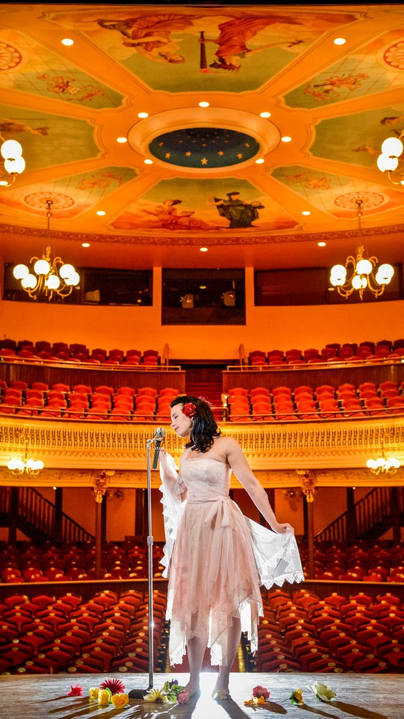 Wilmington indie artist Angela Sheik poses for a portrait inside The Grand Opera House on November 17, 2013.