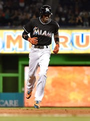 Dee Gordon rounds second as he's overcome with emotion