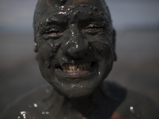 APTOPIX Brazil Mud Carnival