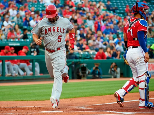 Los Angeles Angels' Albert Pujols (5) scores on a single by Jefry Marte during the first inning of a baseball game against the Texas Rangers in Arlington, Texas, Tuesday, April 10, 2018. (AP Photo/Cooper Neill)