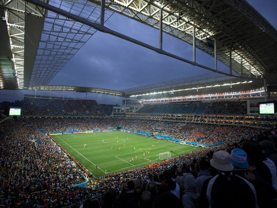 Soccer fans watch the World Cup semifinal match between the Netherlands and Argentina in the Itaquerao Stadium, in Sao Paulo Brazil, Wednesday, July 9, 2014. The match remained scoreless at haltime (AP Photo/Felipe Dana)