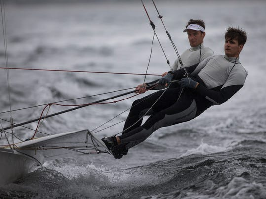 Austria's 49er class Nikolaus Resch, right, and Nico Delle Karth, train on the waters of Guanabaray bay between Niteroi and Rio de Janeiro, Brazil, Sunday, July 27, 2014. International sailors are gathering for the first test event of the 2016 Olympics in Rio de Janeiro, concerned about water pollution in Guanabara Bay that some have likened to a sewer. (AP Photo/Felipe Dana)
