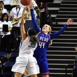 Reno' senior Mallory McGwire blocks a shot by Centennial's Megan Jefferson during the 2016 NIAA Division State Basketball Championships at Lawlor Events Center on Feb. 25, 2016. Centennial beat Reno 82-53.