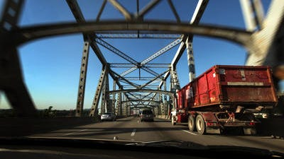 """Photo taken from a dahsboard of a car on southbound I-71/I-75 on the Brent Spence Bridge. The Federal Highway Administration's 2010 National Bridge Inventory rates the Brent Spence as """"functionally obsolete,"""" meaning that it is no longer adequate for its task."""