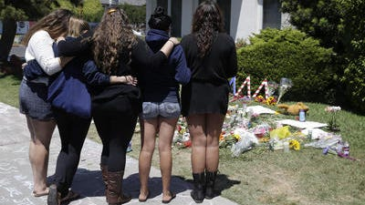 Mourners outside makeshift memorial at the Alpha Phi sorority house at University of California-Santa Barbara