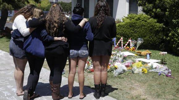 Mourners outside makeshift memorial at the Alpha Phi sorority house at University of California-Santa Barbara