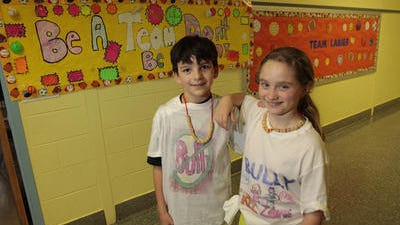 Ian Jaslow and Tara Bertolino show off their anti-bullying tee-shirts at the Stony Point Elementary School on in May 2012.