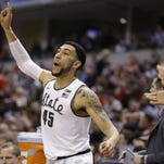 Michigan State's Denzel Valentine (45) reacts on the bench during the second half of an NCAA college basketball game against Ohio State in the quarterfinals at the Big Ten Conference tournament, Friday, March 11, 2016, in Indianapolis. AP Photo/Michael Conroy)
