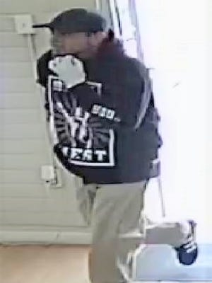 A man robs a Metro PCS shop in Central El Paso on April 13.