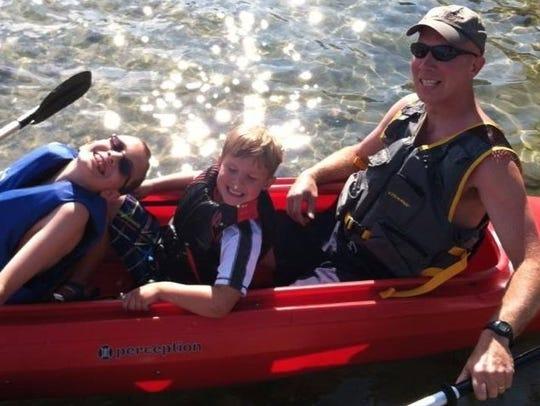 John Bieniewicz, 44,  right, with two boys.