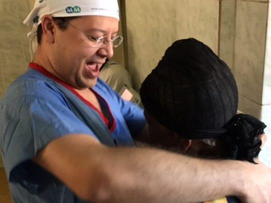 Dr. Juan Fernandez, of University of Louisville, embraces a patient following successful cataract surgery.