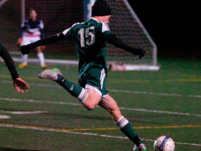 Senior captain Ari Hollander fires a shot at the opposing net.