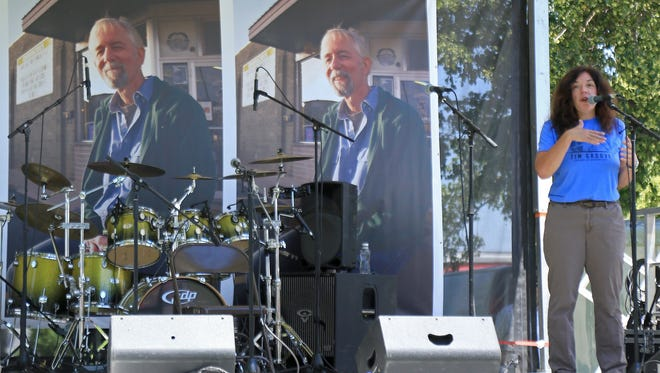 Lisa Cretsinger speaks during a memorial concert for her late husband, Tim Cretsinger, in June at Cedar City's Main Street Park. Another memorial for Tim will be held Sept. 30 at the Cedar Canyon Nature Park.