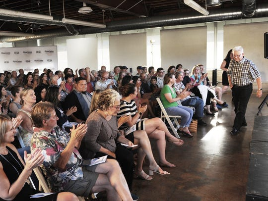 """Guests applaud Louis """"Chuck"""" Samonsky Jr. after he presented his story as part of the Ventura Storytellers Project at the Bell Arts Factory in Ventura. Samonsky was part of the August 2018 show, """"On the Road."""""""