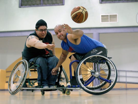 Julio Ayala, left, knocks the ball from the hands of Cruz Gutierrez during the El Paso Air Wheelers practice Monday. The team will face the Las Cruces Rollers on October, 3 as part of Ability Awareness Week which runs from Oct. 3-7. October is Disablility Awareness Month.
