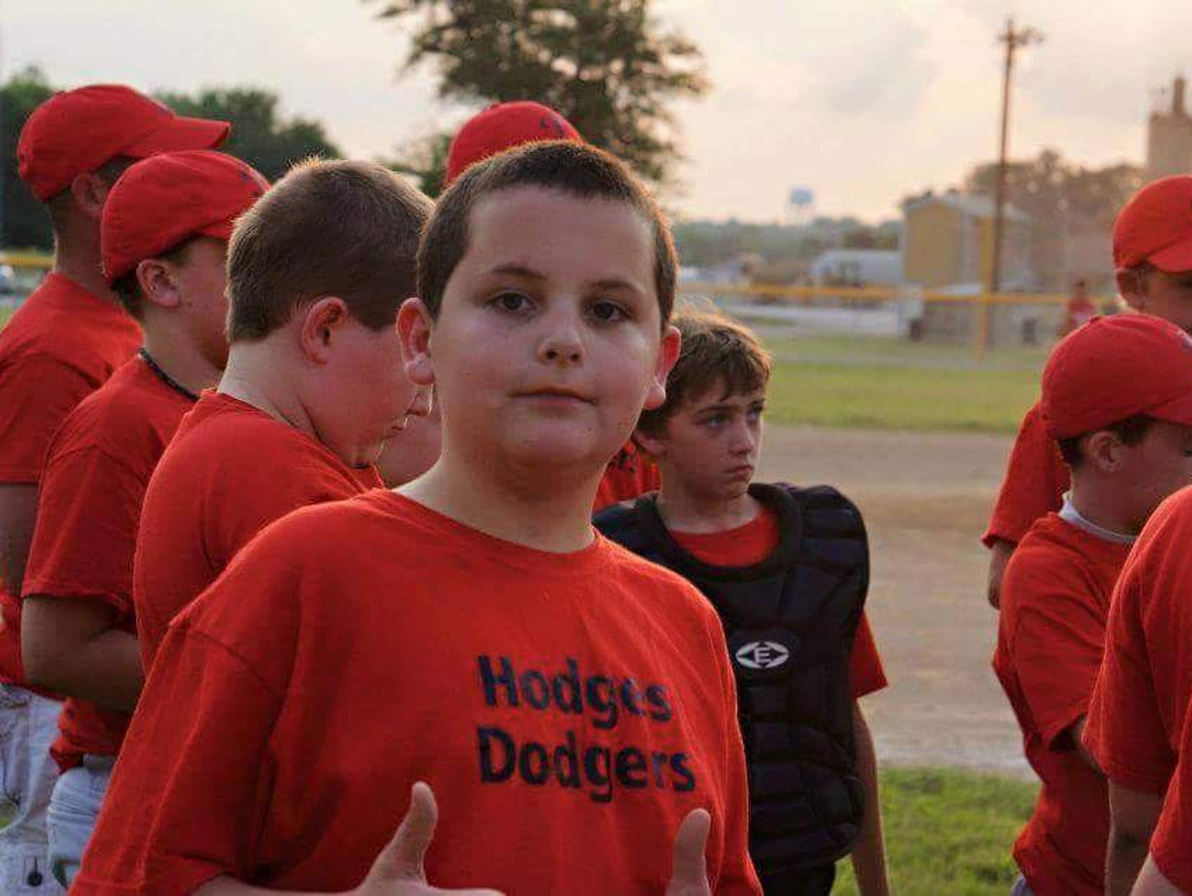 Robert loved sports, including baseball.