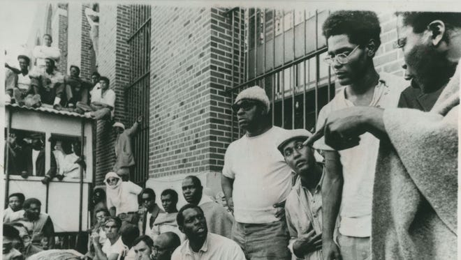 A new court ruling isn't likely to shed light on whether Elliott Barkley, second from right, the Rochester man who spoke for Attica prisoners, was murdered during the retaking of the prison in 1971.