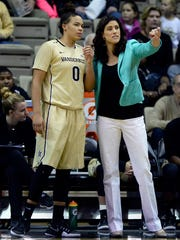 Vanderbilt coach Stephanie White talks with forward Kayla Overbeck (0) during the first half of an NCAA college basketball game against Louisville on Dec. 21, 2016.