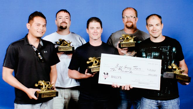 Members of Bigs Gravy Train pose with their winnings and trophies from the VNEA World Pool Championships, held May 26-June 4 in Las Vegas. (Left to right: Sam Disse, Marc Phillips, Matt Montgomery, Brian Ruth, Chad Pew)