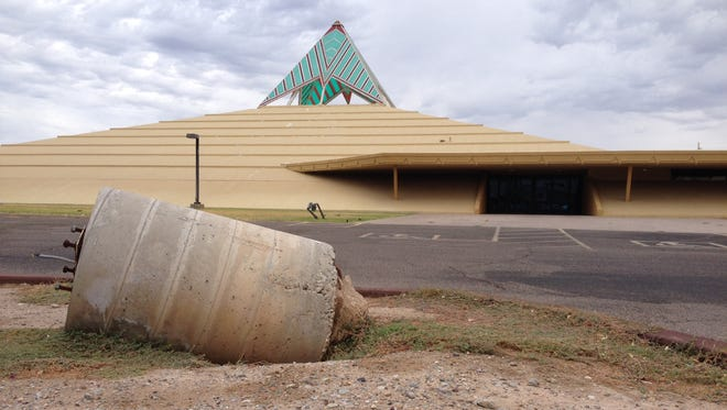 Neighbors are noticing peeling paint and a crumbling parking lot at the TrendsettersChurch International, a pyramid-shaped building formerly known as Capstone Cathedral.