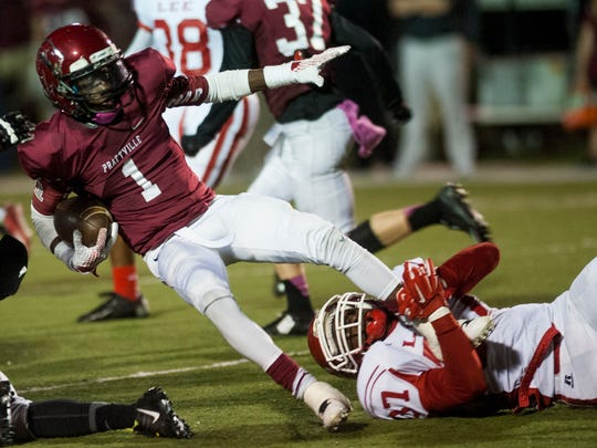 Prattville's DeKeith Whatley (1) is tripped up by lee's