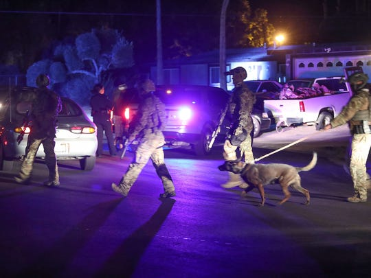 An anti-gang task force searches homes in the in Palm Springs Gateway Estates neighborhood, December 20, 2017.