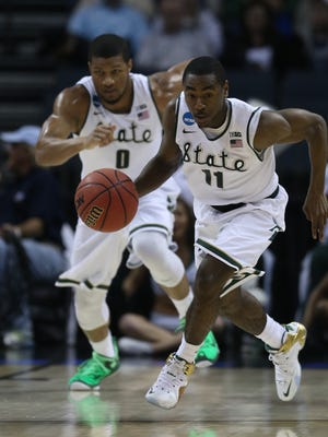 Michigan State's Lourawls (Tum Tum) Nairn makes the steal against Georgia's Marcus Thornton during the first half Friday in Charlotte, N.C.