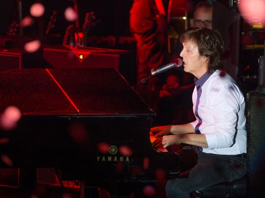 Paul McCartney and his band perform a secret Valentine's Day concert at Irving Plaza on Saturday, Feb. 14, 2015, in New York.